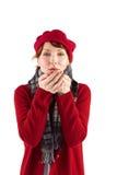 Woman blowing kiss to camera Stock Image