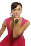 Woman blowing kiss. Young woman blowing a kiss across her palm Royalty Free Stock Photography
