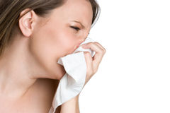 Woman Blowing Nose. With tissue Stock Image