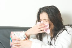 Sneezing woman. With cold or allergies Royalty Free Stock Photo