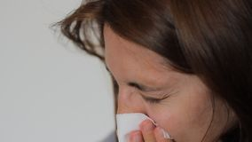 Woman is Blowing Nose stock video footage