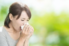Woman blowing nose Stock Photography