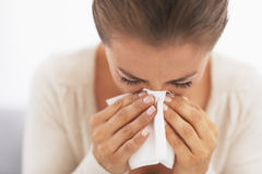 Woman blowing nose into handkerchief. High-resolution photo Stock Photography