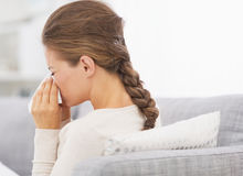 Woman blowing nose into handkerchief. High-resolution photo Royalty Free Stock Photo
