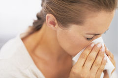 Woman blowing nose into handkerchief. High-resolution photo Royalty Free Stock Images
