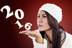 Woman blowing numbers 2016 royalty free stock photo