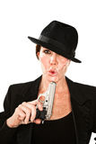 Woman Blowing On The End Of A Smoking Gun Royalty Free Stock Photo