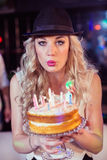 Woman blowing out candles Stock Photos