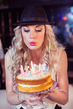Woman blowing out candles Royalty Free Stock Image