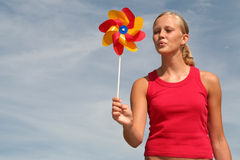Woman Blowing Pinwheel Stock Photos