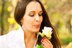Woman blowing on a rose Royalty Free Stock Images