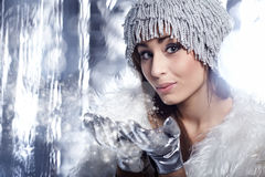 Woman Blowing Snow. Winter concept Royalty Free Stock Photography