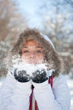 Woman blowing snow. Young woman blowing snow, winter fun Royalty Free Stock Photography