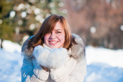 Woman blowing in the snow Royalty Free Stock Photography