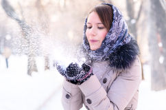 Woman is blowing snow Royalty Free Stock Photo
