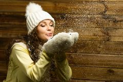 Woman blowing snow Stock Photography