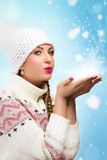 Woman Blowing Snow Royalty Free Stock Photo