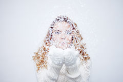 Woman Blowing Snow, girl in  warm knitted scarf Stock Photography