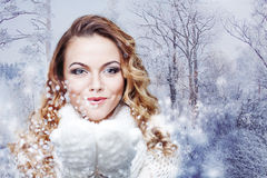Woman Blowing Snow, girl in  warm knitted scarf Royalty Free Stock Photos