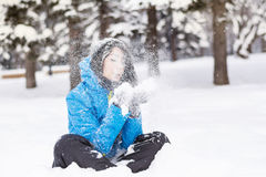 Woman blowing snow Royalty Free Stock Photos