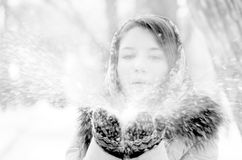 Woman is blowing snow Royalty Free Stock Images