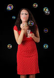 Woman blowing soap bubble Royalty Free Stock Photo
