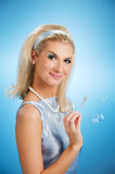 Woman blowing soap bubbles Stock Photography
