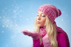 Woman blowing to snowflakes Stock Images
