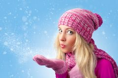 Woman blowing to snowflakes Royalty Free Stock Photo