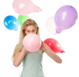 Woman blowing up balloons for a party Royalty Free Stock Photography