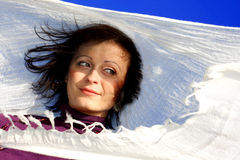 Woman blowing in the wind with a scarf stock image