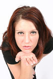 Woman blowing you a kiss royalty free stock images