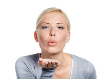 Woman blows a kiss to somebody Royalty Free Stock Image