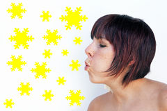 A woman blows off snowy stars Stock Images