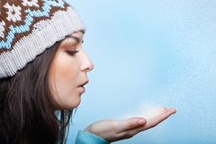 Woman blows the snow Royalty Free Stock Photos