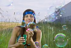 Woman blows soap bubbles Royalty Free Stock Photo