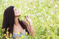 Woman blows soap bubbles royalty free stock photo
