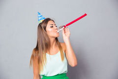 Woman blows in whistle Stock Photography
