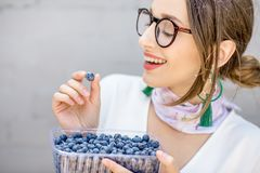 Woman with bluberries Stock Image