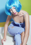 Woman with Blue Artificial Dyed Hairs Sitting Royalty Free Stock Image