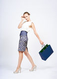 Woman with blue bag Stock Images