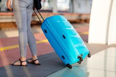 Woman with blue baggage suitcase royalty free stock image