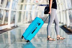 Woman with blue baggage suitcase stock photography