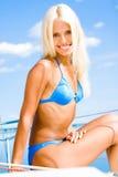 Woman in blue bikini stock photography
