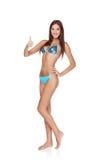 Woman in blue bikini gesturing thumb up Stock Photos