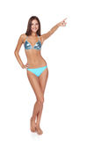 Woman in blue bikini pointing to copy space Stock Images