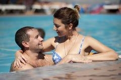 Woman in Blue Bikini Top Hugging Topless Man Royalty Free Stock Photos