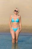 Woman in a blue bikini Royalty Free Stock Photography