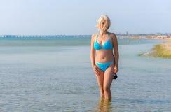Woman in a blue bikini Stock Photography