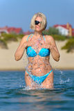 Woman in a blue bikini Royalty Free Stock Images
